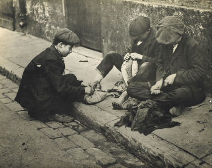 Three boys in rags: c.1900