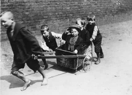 Boys playing with a cart: c.1900