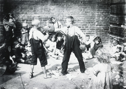 The Noble Art in Humble Surroundings: Shoeless children boxing: c.1900
