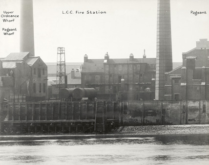 Thames Riverscape showing Upper Ordnance Wharf, Pageant Wharf and the L.C.C. Fire Station: 1937