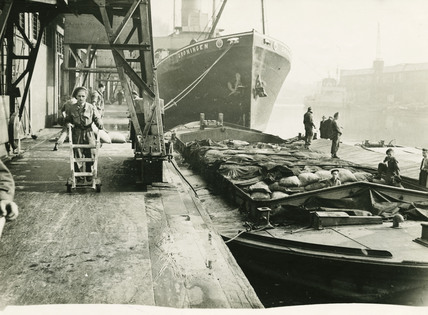 Soldiers unloading supplies during dock strike:1945