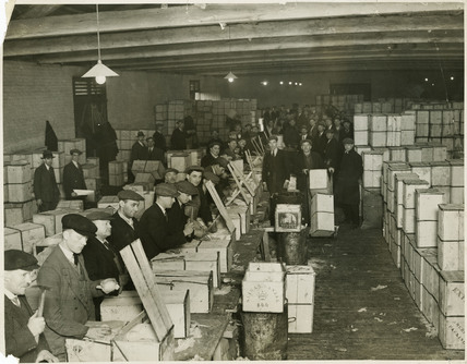 Re-packing  Jaffa oranges in 'P' Warehouse, Millwall Dock: 1930