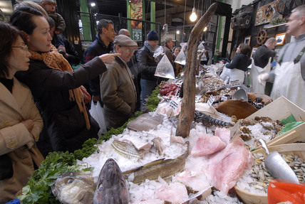 People buying fish on a stall in Borough Market; 2008