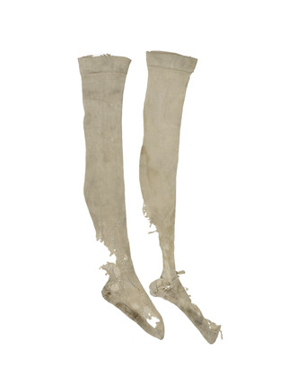A pair of very torn, knitted silk stockings for artist's lay figure: 18th century