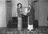 Anna Neagle presenting a prize to Mae Pope, winner of a Swan and Edgar competition