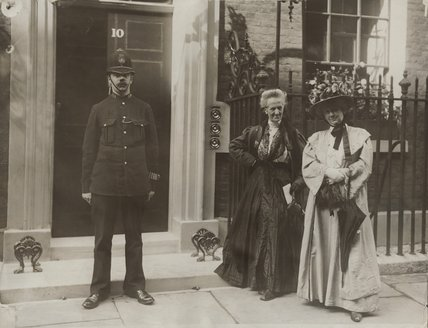Charlotte Despard (née French) and Anne Cobden-Sanderson with a policeman