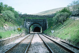 Railway line heading into a tunnel.