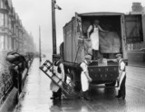 Removal men unloading  from a road-rail container, London, 1931.
