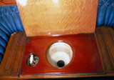 Wooden commode with decorated bowl in Queen