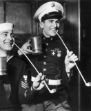 American sailors smoking clay pipes and drinking from tankards, 1942.