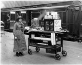 An attendant with the 'Snack Box' refreshment trolley, 19 April 1921.