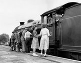 Schoolchildren chat to the driver and fireman of steam locomotive, June 1955.