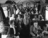 Pupils seated in the carriage, en route for