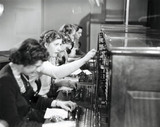 Operating a switchboard, 1951.