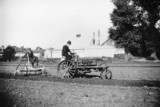 Ivel tractor pulling cultivator, c 1900s.