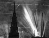 Bombs and searchlights lighting the night sky, London, 1 September 1940.