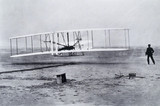 The Wright Brothers' first powered and sustained flight, 17th December 1903.