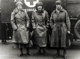Three nurses standing outside their ambulance, England. c 1914-1918