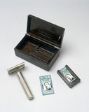 Gillette safety razor with its original bakelite box, c 1930s.