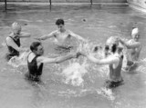 People splashing in a pool, Chiswick open-air baths, London, 13 May 1931.