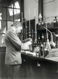 Conducting a volumetric analysis experiment, 17 July 1931.