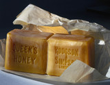 'Queen's Honey' soap removed from its packet, c 1890-1914.