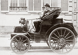 C S Rolls at the wheel of his 8 hp Panhard motor car, France, 1898.