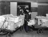 Loading sunday newspapers on the Belfast boat train, Euston Station,1937.