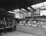 Women volunteers running the free buffet at Paddington station, c 1914.