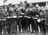 Soldiers of Kitchener's army with their Christmas dinner, 1914-1918.
