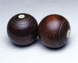 Two wooden antique lawn bowls, 19th century.