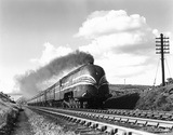 Steam locomotive 'Coronation' with train, Shap Summit, Cumbria, 1937.
