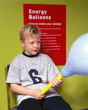 Boy blowing up a balloon for the 'Energy Balloons' event, Science Museum, 2000.