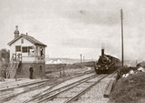 Steam locomotive pasing Uphill Junction, Somerset, c 1900s.
