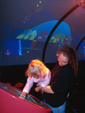 The curved cartoon screen in the Pattern Pod, Science Museum, London 2000.