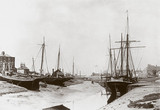 Boats at low tide, late 19th century.