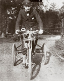 C S Rolls sitting on a de Dion tricycle, Cambridge, 1897.