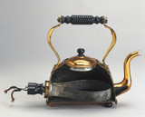 Electric copper kettle, with immersed element, sectioned, c 1921.