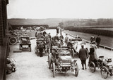 Motor cars parked outside a country house during the 1000 Mile Trial, 1900.