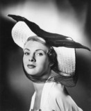 Glamorous woman wearing a wide-brimmed hat,