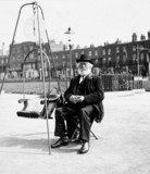 Old man with weighing chair, 1900s.