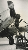 Loading baggage into an Avro Lancastrian airliner, c 1940s.