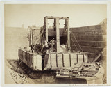 Dredger in dry dock for damage inspection, Leith, Scotland, c 1863.