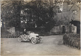 Motor car outside a country house, c 1912.
