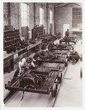 Workers building railway trolleys, c 1930.
