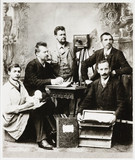 Group of photographers and assistants with equipment, 19th century.