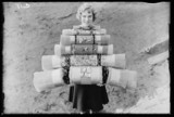Woman carrying Christmas crackers, 1932.