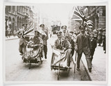 'Peace scenes in London wounded soldiers with flags', 1919.