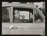 Motorist taking pills, 1953.