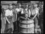 Coopers with a man in a barrel, 1934